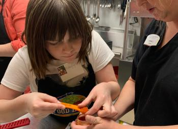 In Cooking Matters for Families, mothers, fathers, grandparents and other adults worked alongside their children to learn about and prepare healthy recipes together.
