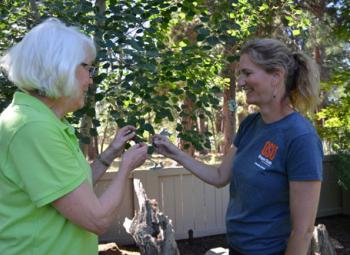 OSU Extension faculty Amy Jo Detweiler gives advice to Master Gardener Deb Goodall.